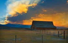Barn and Distant Forest Fire at Sunset - Montana